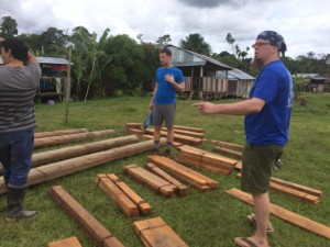 Tyler Vogel '17 and Dr. Michael Bechtel '94, assistant professor of science education, help construct the bat house in the Maijuna community in Peru.