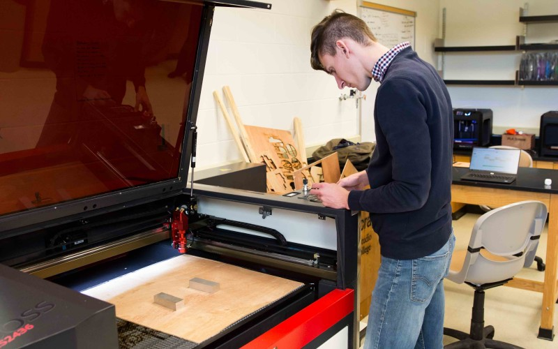 Jake Hamilton '18 programs a new project for the laser printer in the Innovation Studio.