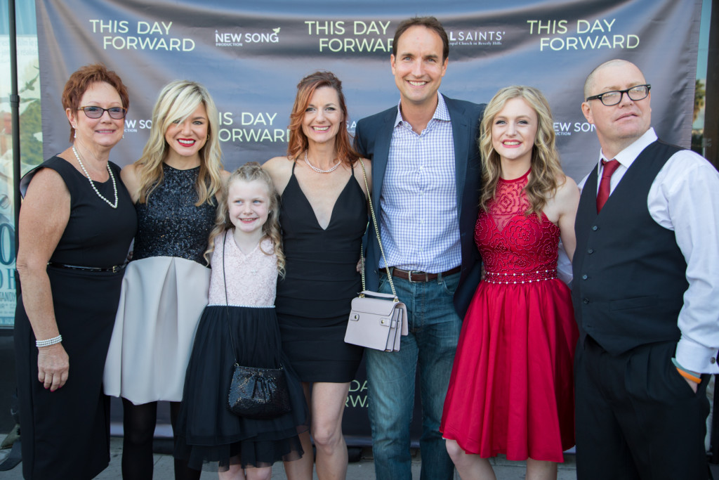 "The Jensens joined Brian Ide '96 (center) for the Hollywood premiere of ""This Day Forward."""