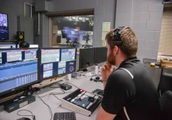 Josh Voigt '20 works in the Knight Vision production booth during a home football game.