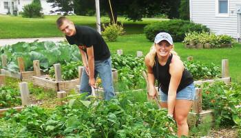 LSS HSLI students wotking in Waverly community garden