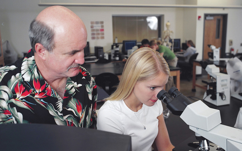 Dr. Ventullo and Student with Microscope