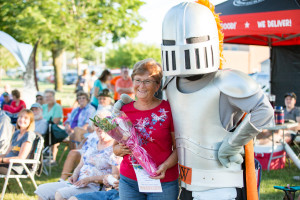 Sir Victor delivers flowers at Concerts in Kohlmann Park in July 2018
