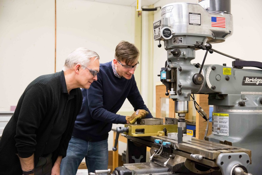 Jake Hamilton '18 and Dr. Daniel Black watch as the newly automated mill begins a project.