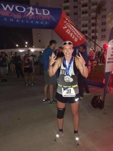 Sarah Lacina celebrates the finish of the World Marathon Challenge.