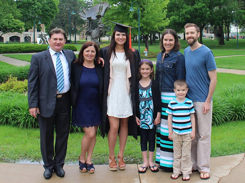 "Andjelka Zoranovic '15 with her ""two families"" at graduation."