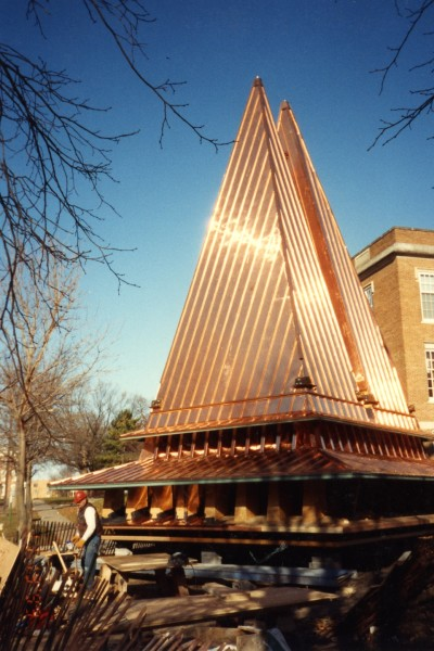 Chapel spires are prepared to be lifted to the top of the chapel