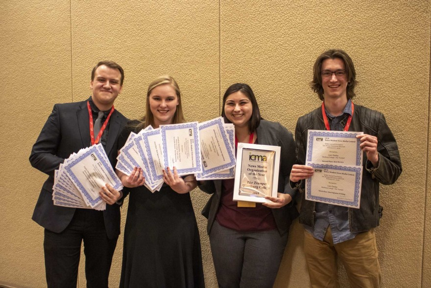 Ryan Reebenacker, Annika Wall, Silvia Oakland and Liam Easley show off the awards The Trumpet staff members earned at the ICMA conference.