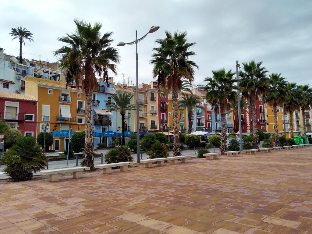 Colorful building fronts on a street in Villajoyosa, Spain