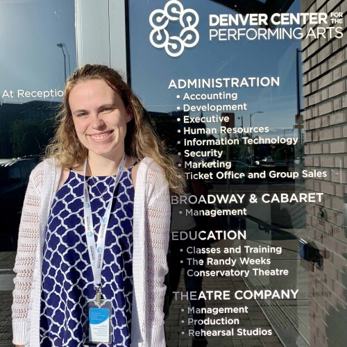 Alexis Green stands outside the Denver Center for the Performing Arts building