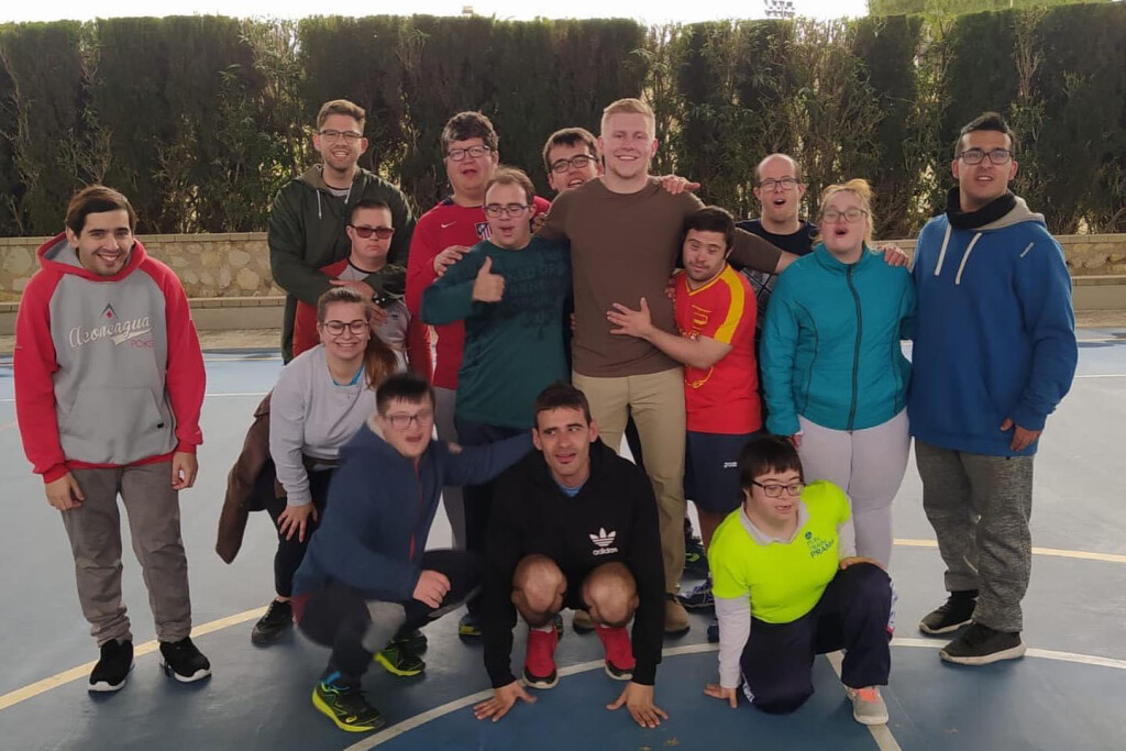 Tanner Duffy poses with a group of adults with disabilities he worked with while studying abroad in Alicante, Spain.