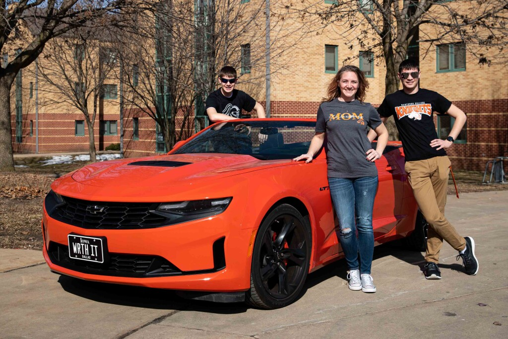 Laura Hofer Hinspeter and her sons, Brenden and Brody, with Laura's Wartburg orange Camaro.